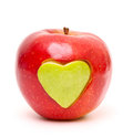 Red apple and  heart shape cut and inserted Royalty Free Stock Image