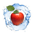 Red apple with leaves and water splash isolated on white Stock Images