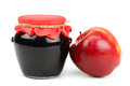 Red apple and pot of jam Stock Image