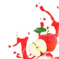Red apple splash photo of with leaf slice and isolated on white Stock Photos