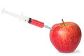 Red apple and syringe Stock Image