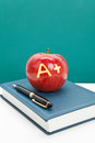 Red apple and Textbook Royalty Free Stock Photo