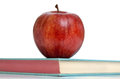 Red apple top vintage school book isolated white background Stock Photo