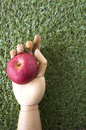 Red Apple In Wooden Hand