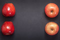 Red apples fresh on dark gray background with space for text Stock Image