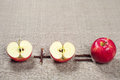 Red apples and halves apple two on background fabric Stock Image