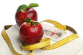 Red apples and a measuring tape over white Royalty Free Stock Photo