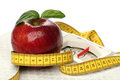 Red apples and a measuring tape over white Stock Images