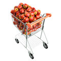 Red apples in a shopping cart. Royalty Free Stock Image