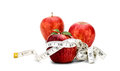 Red apples with tape measure isolated health and fitness concept and white in inches Royalty Free Stock Images