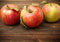 Red Apples on Wood Stock Photos