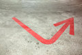 Red arrow on the floor of parking concrete empty garage Stock Photo