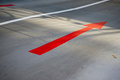 Red arrow on road closeup of in underground car park Stock Photo