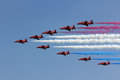 Red arrows flying display with smoke Royalty Free Stock Image