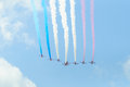 The red arrows london uk circa june are doing a flypast over buckingham palace Royalty Free Stock Photography