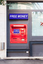 Red ATM earning free money Royalty Free Stock Photo