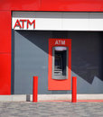 Red atm in a wall generic Stock Photography