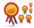 Red award ribbon rosette or gold medal. Royalty Free Stock Photography