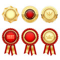 Red award rosettes and gold heraldic medals