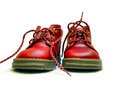 Red baby shoes or kid isolated on white old paper background Stock Images