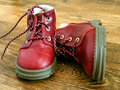 Red baby shoes or kid on wood floor Stock Image