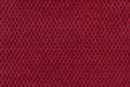 Red background from soft fleecy fabric closeup. Texture of textile macro Royalty Free Stock Photo