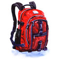 Red backpack standing isolated on white background