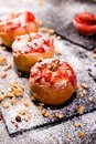 Red Baked Apples Stuffed Cottage Cheese And Granola Royalty Free Stock Photo