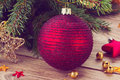 Red ball decoration and fir tree christmas with retro toned Stock Photo