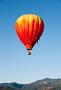 Red Balloon Over Colorado Mountains Royalty Free Stock Image