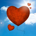 Red balloons heart shape flying away in the blue sky Royalty Free Stock Photos