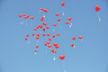 Red balloons with the messages in blue sky Royalty Free Stock Photo