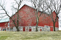 Red Barn Behind Trees Royalty Free Stock Photo