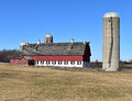 Red barn and cement silo Royalty Free Stock Photo