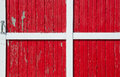 Red barn door bright with white wood trim Stock Image