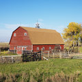 Red barn and fence Royalty Free Stock Photography