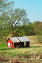 Red barn old little in a meadow Royalty Free Stock Photo