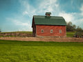 Red barn simple in spring Royalty Free Stock Photography