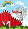 Red barn and wind turbine on the farm Royalty Free Stock Photo