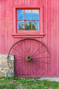 Red Barn, Window and Wagon Wheel Royalty Free Stock Photo