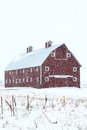 Red Barn in Winter Storm Royalty Free Stock Image