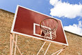 Red basketball board over brick wall and blue sky Stock Photos