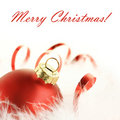 Red bauble and ribbon Royalty Free Stock Images
