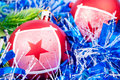 Red baubles on the blue garland Royalty Free Stock Images