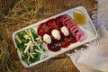 Red beet, greens, rings of onions with yellow cream and pastry, Royalty Free Stock Photo