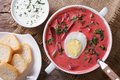 Red beet soup with egg and sour cream. Horizontal top view Royalty Free Stock Photo