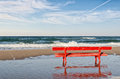 Red bench on the beach an empty Royalty Free Stock Images