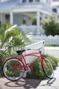 Red bicycle in front of house. Royalty Free Stock Photo