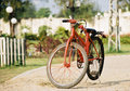 Red bicycle - Laos Stock Image