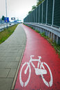 Red bicycle path sign of a bike Stock Photography